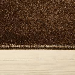 Taupe farvet løst tæppe med kant