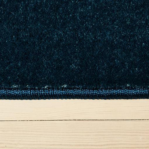 vintage blåt farvet tæppe med kant