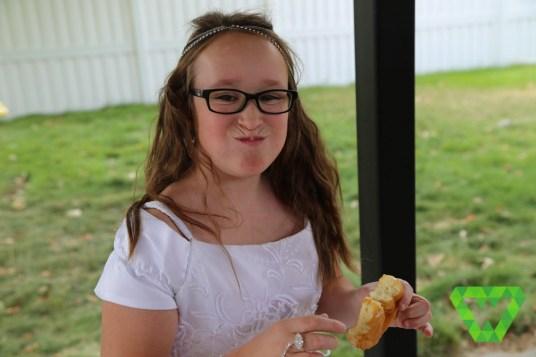 Rebecca (Lady Galadriel) enjoying her donut