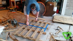 making the fence. Take a palate, break out every other board then cut in half.