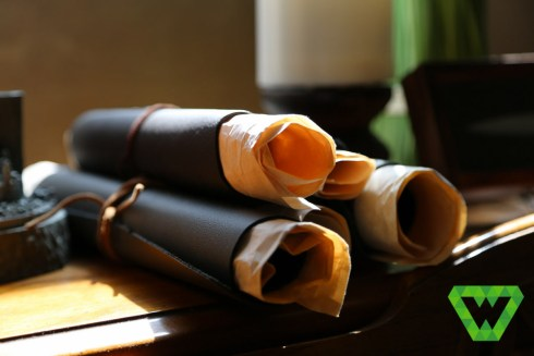 Spare pieces of leather rolled up with crumpled parchment paper. To make these extra long I used two 8.5x11 paper sheets so they'd extend beyond the leather. Simple leather string kept them tied.