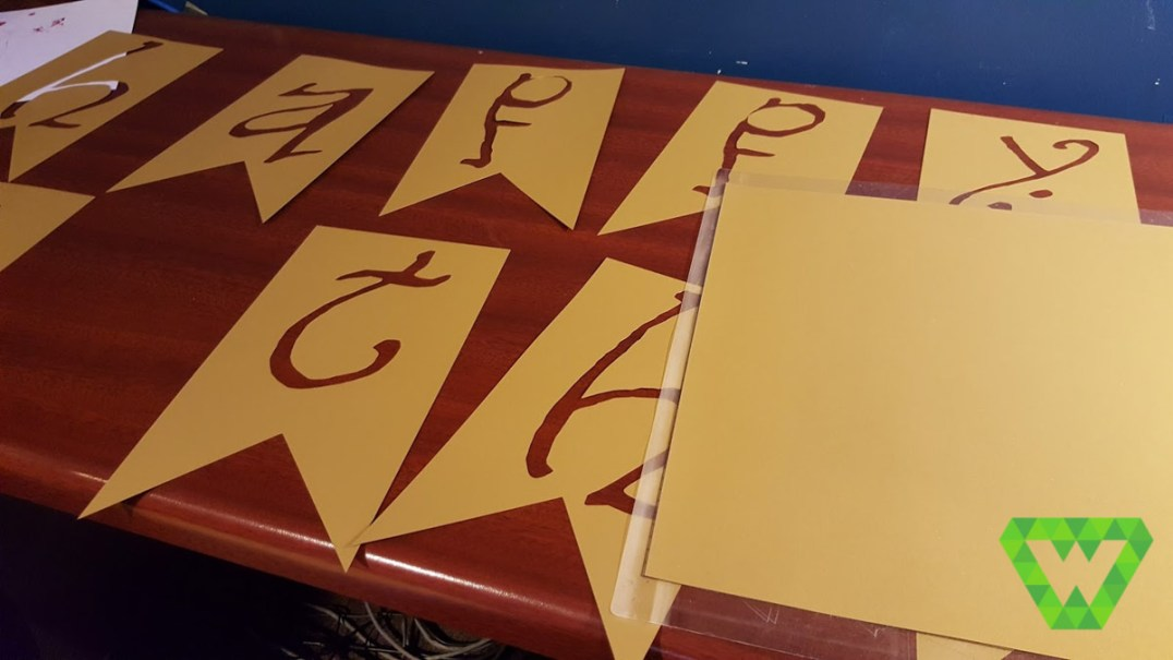 making the Happy Birthday sign...cutting with the Silhouette Cameo.