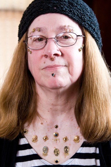 "Gabby Frieder Once convinced she just could not be pierced because her piercings were constantly rejected, about seven years ago Gabby walked into Nomad. Blake informed her she might have a nickel allergy and his implant-grade metals wouldn't have that problem. Since then, the semi-retired special education teacher has continued to add to her microdermal adornment. This ""necklace"" only represents a small part of the work Blake has done for Gabby over the years. Most of these pieces were designed by Blake at Nomad Piercing Studio."