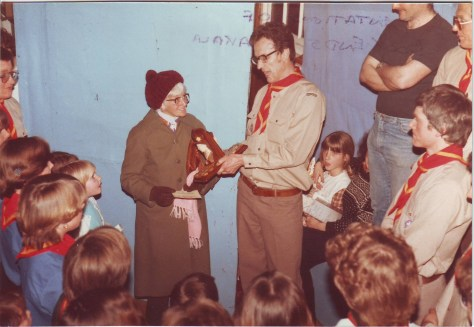 Akela receiving a presentation from 27th Woolwich Group Scoutleader Brian Watling. This was taken backstage at one of the  District Scout and shows held at Wesley Hall (Showtime), 1984 or 1985