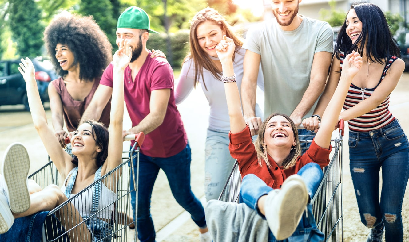 Group of happy and diverse Gen Z people shopping, showing a concept of effective Gen Z advertising.