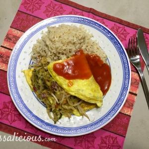 Chinese omelet met zoete tomatensaus en zilvervliesrijst