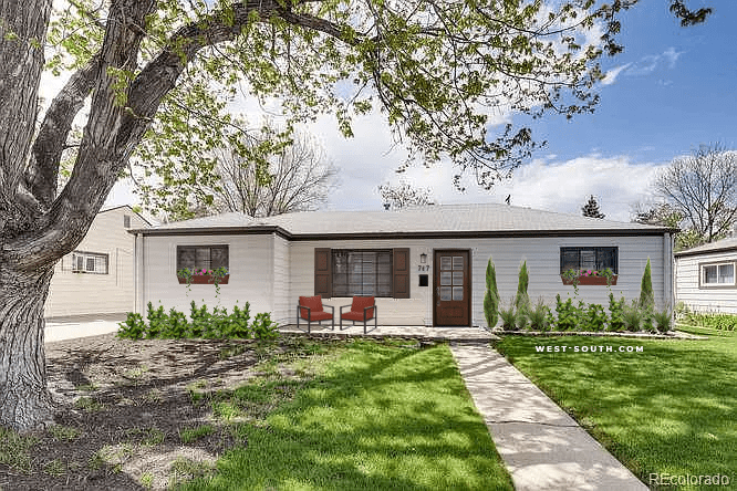white sided house with moderate curb appeal updates