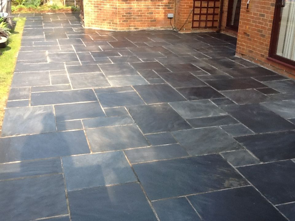cleaning slate on a client s patio