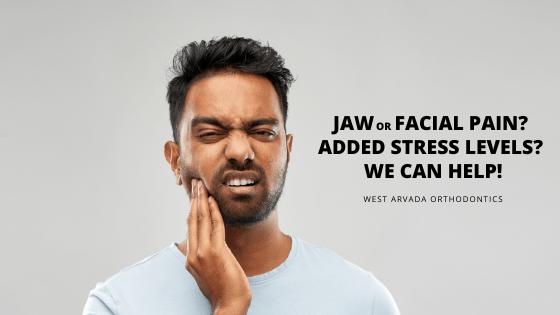 man showing facial pain