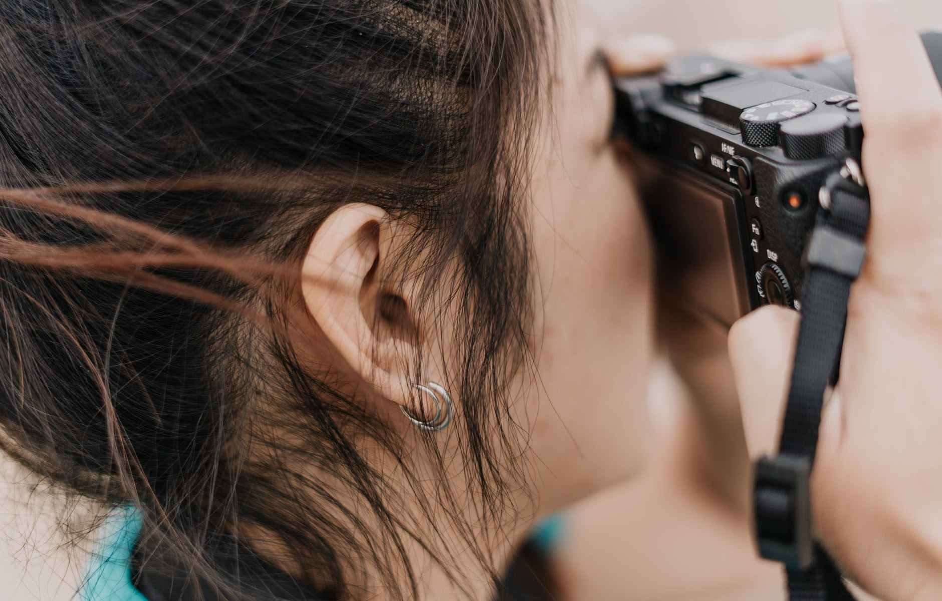 close up photo of woman holding a camera