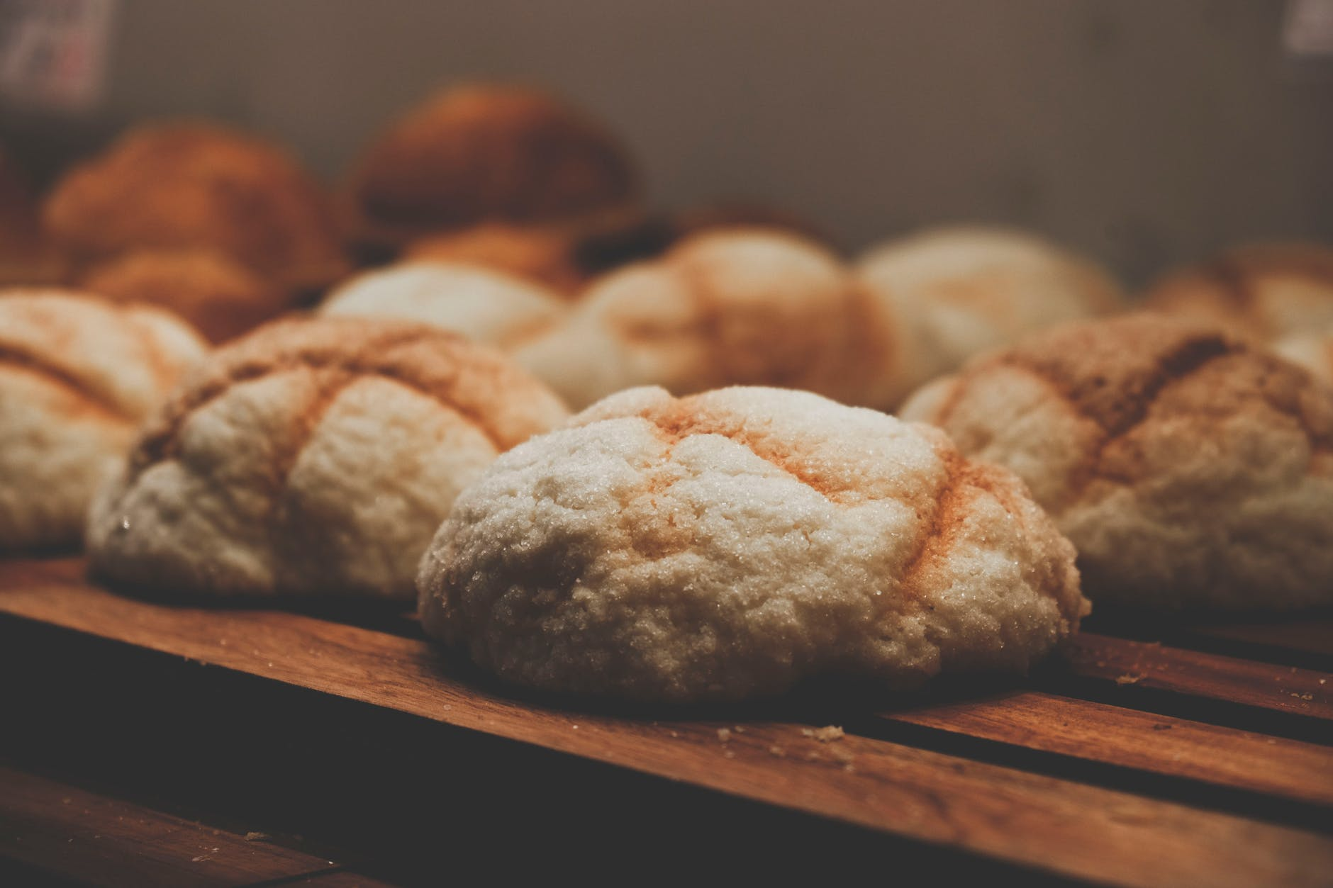 baked cookies on brown wooden surface