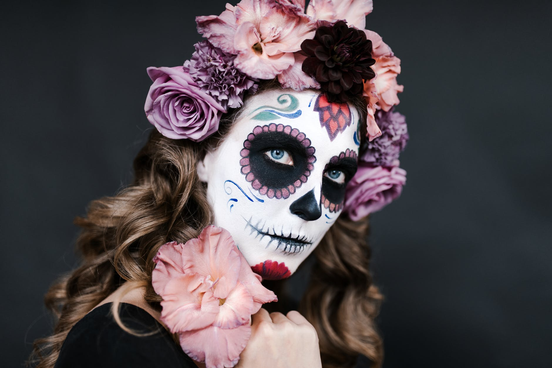 woman with candy skull visage for day of dead