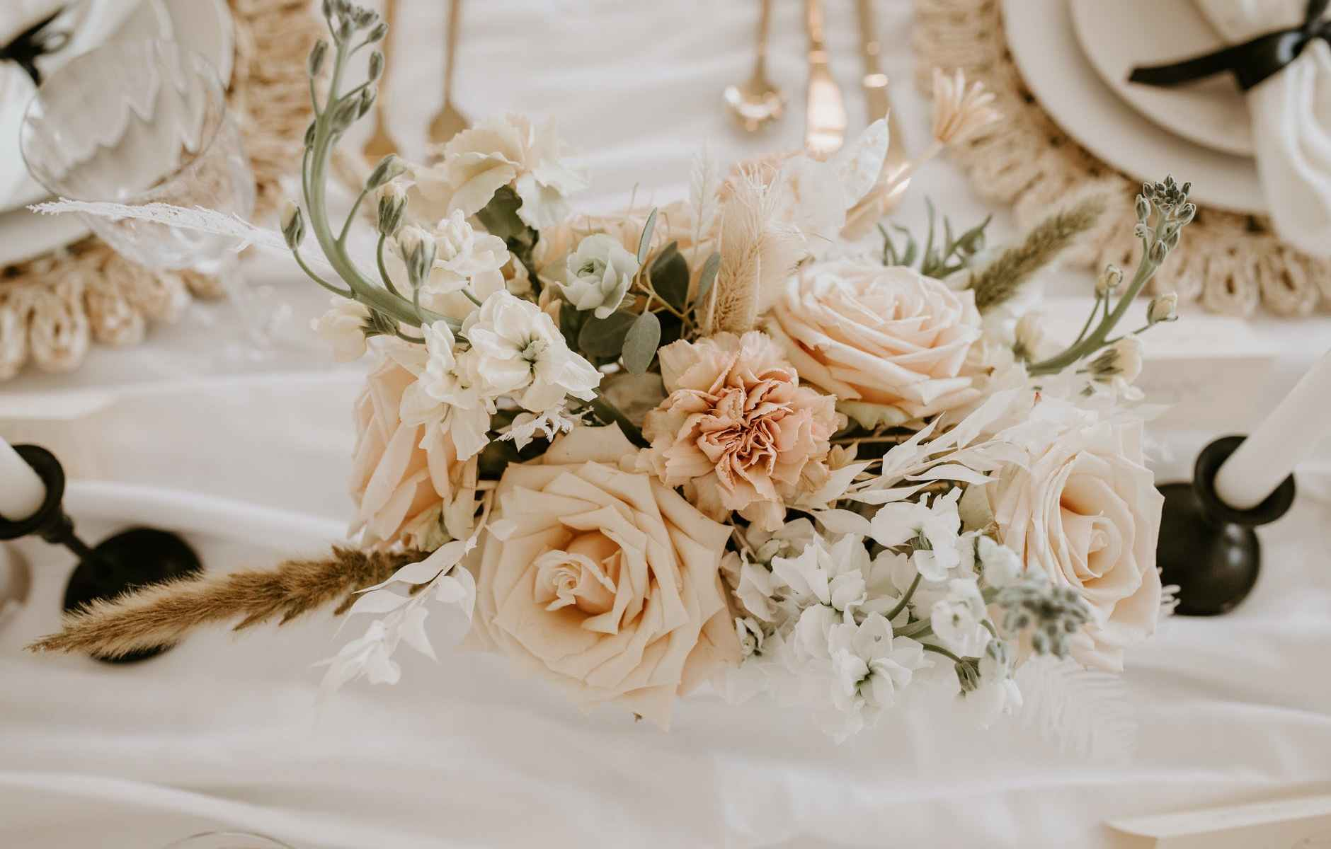 elegant flowers placed on table near candles