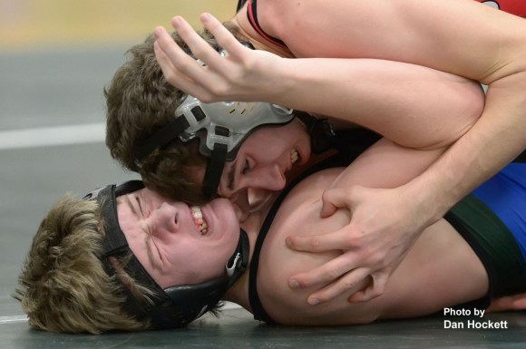 Photo by Dan HockettWest Burlington – Notre Dame – Danville's Brock Dowell (bottom) is pinned by Highland's Casey Castillo (top) during the West Burlington Triangular Thursday night in West Burlington. Columbus placed first 3-0; Highland took second 2-1; West Burlington placed third 0-3.