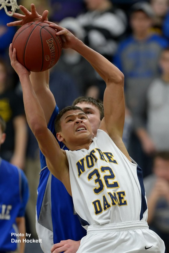 Photo by Dan Hockett Notre Dame's Xavier Williams (32) shoots against Danville during Thursday night's game at Father Minett Gymnasium in Burlington. Danville defeated Notre Dame, 83-46.