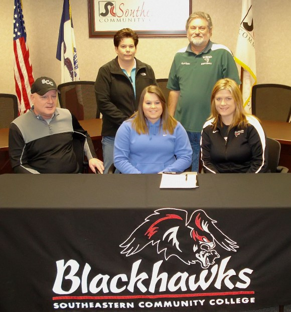 Photo by Becky FraiseWest Burlington / Notre Dame's Regan Fraise signs letter of intent Tuesday to play softball for Southeastern Community College.Left to right:  SCC Asst. Coach Larry Heath,  Regan Fraise, SCC Head Coach Melissa NavntoftStanding:  Becky Fraise,   WBND Head Coach David Oleson