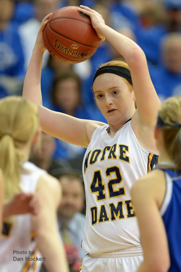 Photo by Dan Hockett Notre Dame's Emily Salvador hauls in a rebound against Colo-NESCO in the Class 1A State Quarterfinal at Wells Fargo Arena in Des Moines Monday afternoon.  Notre Dame defeated Colo-NESCO, 60-43.