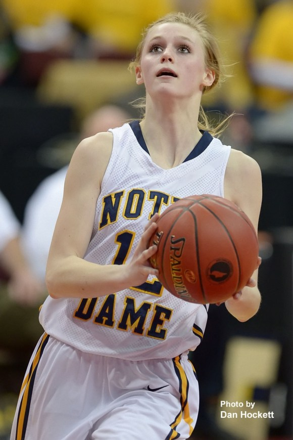 Photo by Dan Hockett Notre Dame's Kori Mesecher looks to the basket against Colo-NESCO in the Class 1A State Quarterfinal at Wells Fargo Arena in Des Moines Monday afternoon. Hickey led all scorers with 17-points. Notre Dame defeated Colo-NESCO, 60-43.