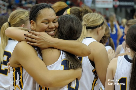 Photo by Dan Hockett Notre Dame Seniors Alex Yacko and Morgan Myers embrace in celebration after defeating Colo-NESCO, 60-43, in the Class 1A State Quarterfinal at Wells Fargo Arena in Des Moines Monday afternoon. Notre Dame will meet Central Lyon Thursday morning in the Class 1A Semifinal.