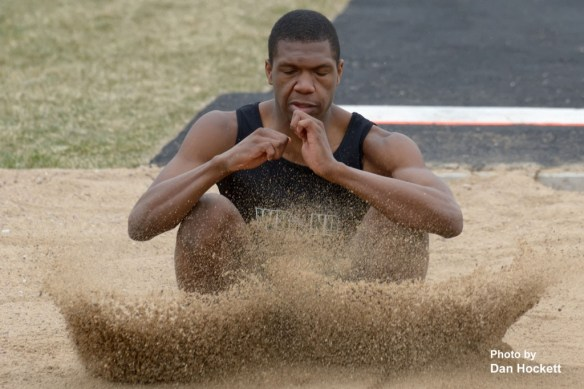 "Photo by Dan Hockett West Burlington – Notre Dame's Timmy Williams lands the long jump Saturday at the West Burlington Coed Relays in West Burlington. Williams placed fourth in the Class-B long jump with a leap of 18'1.25""."