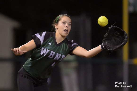 Photo by Dan Hockett West Burlington – Notre Dame Third Baseman Machaela Diaz catches a line drive from a Burlington batter late in the second game of a doubleheader Wednesday night in West Burlington. West Burlington – Notre Dame swept Burlington, 11-1, 5-3.