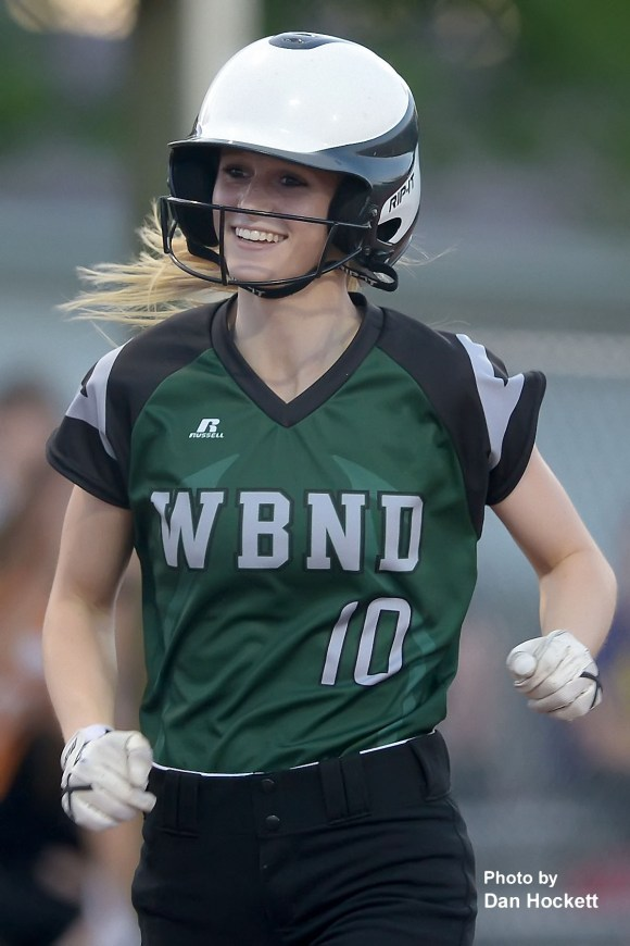 Photo by Dan Hockett West Burlington – Notre Dame's Kori Mesecher smiles as she rounds third after hitting a homerun against Keokuk in the fifth inning Tuesday night in West Burlington. WB-ND finished the night with 3-homeruns against Keokuk. West Burlington – Notre Dame defeated Keokuk, 8-5.