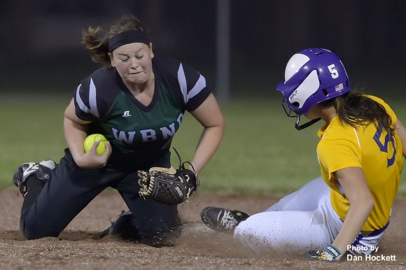 Photo by Dan Hockett West Burlington – Notre Dame Shortstop Regan Fraise (left) makes the tag on Keokuk's Kirby Sanders (5) for the final out to end a seventh inning Keokuk rally Tuesday night in West Burlington. West Burlington – Notre Dame defeated Keokuk, 8-5.