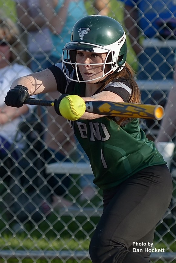 Photo by Dan Hockett West Burlington – Notre Dame's Riley Hale bunts in the first game of a doubleheader against Burlington Wednesday night in West Burlington. West Burlington – Notre Dame swept Burlington, 11-1, 5-3.