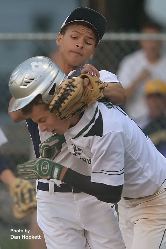 Photo by Dan Hockett Notre Dame Pitcher Xavier Williams tags out West Burlington's Brant Wrede at the plate Monday night in West Burlington. Notre Dame defeated West Burlington, 5-4 in 9-innings.