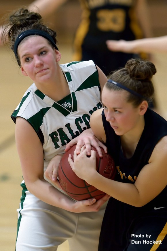 Photo by Dan Hockett West Burlington's Kaylee Dochterman (left) fights for a loose ball with a Central Lee defender Monday night in West Burlington. Central Lee defeated West Burlington, 57-45.