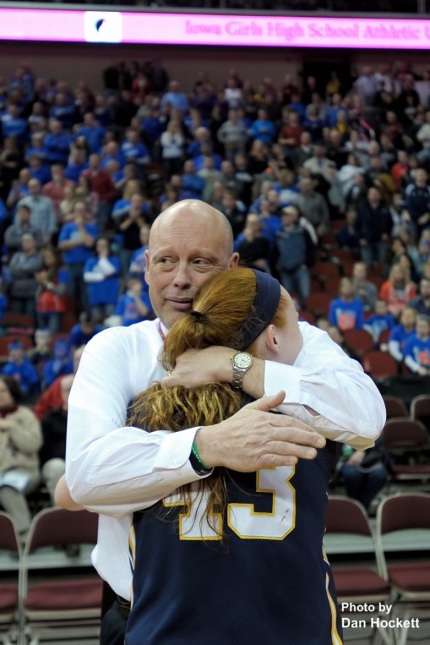 Photo by Dan Hockett Notre Dame Head Coach Kollin Alfred hugs the Nikes only senior, Emily Salvador, after winning the Class 1A State Girls Championship Friday night at Wells Fargo Arena in Des Moines.