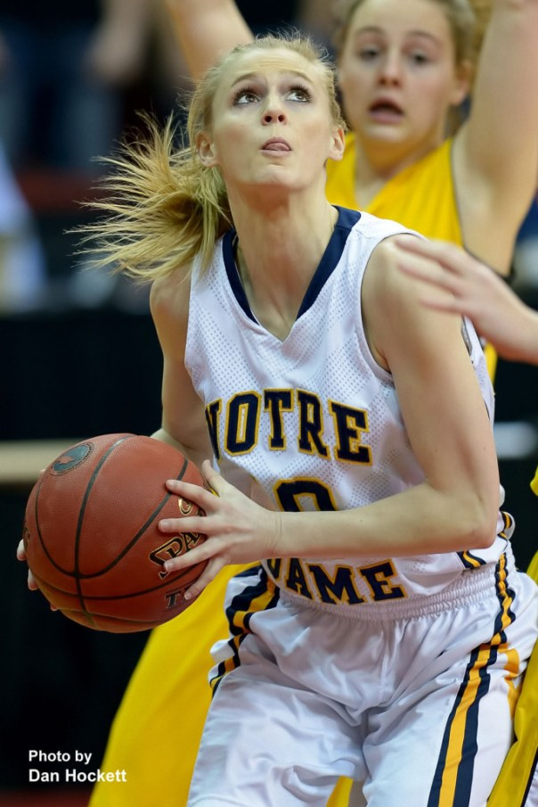Photo by Dan Hockett Notre Dame's Kori Mesecher looks to the basket against Adair-Casey during the Class 1A State Quarterfinal  Monday afternoon at Wells Fargo Arena in Des Moines. Notre Dame defeated Adair-Casey, 90-50.