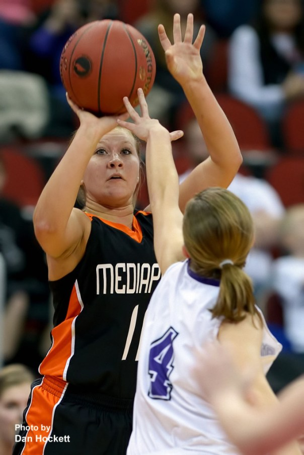 Photo by Dan Hockett Mediapolis' Ashley Hedges shoots a three over MOC-Floyd Valley's Bre Harmelink (4) Thursday in the Class-3A State Semifinal game at Wells Fargo Arena in Des Moines. Mediapolis fell to MOC-Floyd Valley, 64-51.
