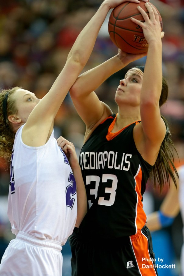 Photo by Dan Hockett Mediapolis' Rachel Holsteen (33) has her shot blocked by MOC-Floyd Valley's Ali Achterhof (24) Thursday in the Class-3A State Semifinal game at Wells Fargo Arena in Des Moines. Mediapolis fell to MOC-Floyd Valley, 64-51.