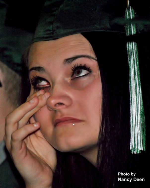 Photo by Nancy Deen West Burlington Senior Makenzie Whitmore tears up during graduation ceremonies at West Burlington High School Gymnasium Sunday.