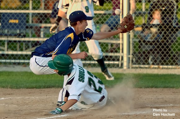 Photo by Dan Hockett West Burlington's Masin Shullaw slides safe to home as Notre Dame Pitcher Jacob Smith misses the throw Friday night in West Burlington. West Burlington defeated Notre Dame, 7-0.