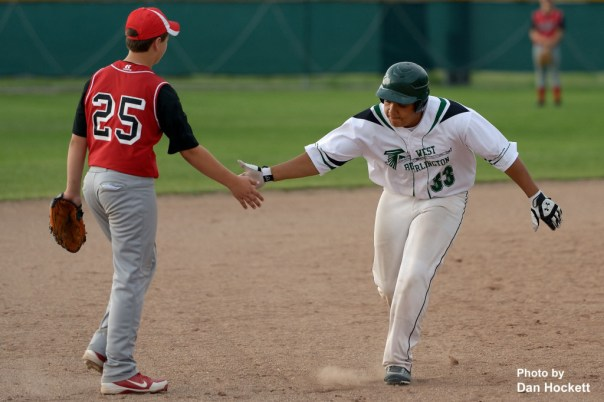 Photo by Dan Hockett West Burlington's Jerod Lewis (33) is congratulated by Harmony's Austin McCarty (25) after slugging a 3-run homer in the third inning Friday night in West Burlington. West Burlington defeated Harmony, 20-0 in 4-innings.