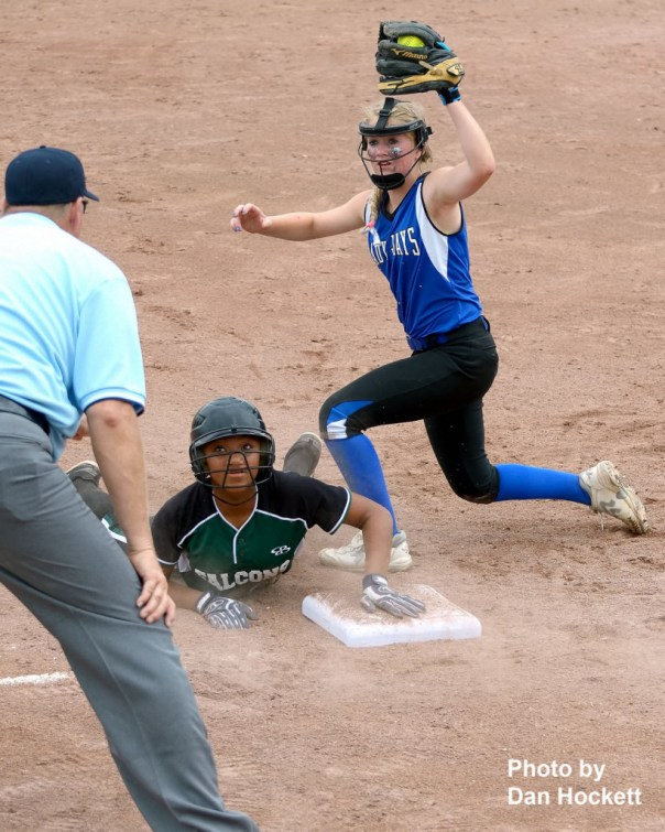 Photo by Dan Hockett West Burlington – Notre Dame base runner Jashira Baylark and Bondurant – Farrar Third Baseman Kenzie Adkins look for the call in the sixth inning of the Class 3A State Quarterfinal Monday at Fort Dodge. Baylark was called out. Bondurant – Farrar defeated West Burlington – Notre Dame, 9-4.