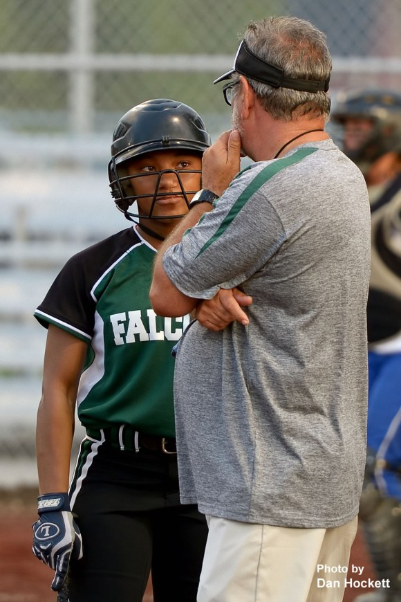 Photo by Dan Hockett West Burlington – Notre Dame's Jashira Baylark confers with Head Coach David Oleson before reentering the batter's box against Danville Tuesday night in Danville. West Burlington – Notre Dame defeated Danville, 12-0, in 6-innings.