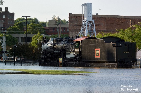 Photo by Dan Hockett Steam Engine 3003 is an island at Division St. & Main St. as the Mississippi River again floods Burlington's riverfront.