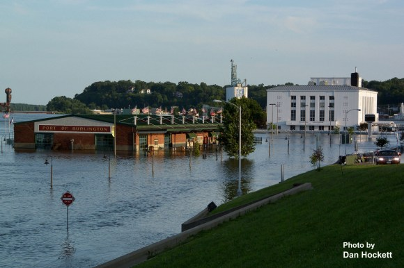 Photo by Dan Hockett It's an all too common occurrence; the Mississippi River again floods Burlington's riverfront.