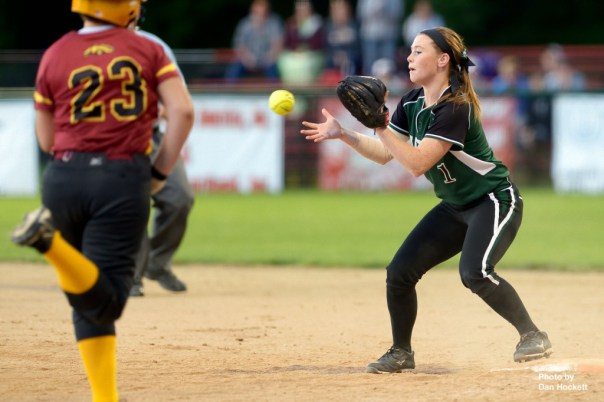Photo by Dan Hockett West Burlington – Notre Dame Second Baseman Riley Hale makes the play at first against PCM's Krystal Pendroy during the Region-7 Final in Ottumwa Monday night. West Burlington – Notre Dame defeated PCM, 6-4.