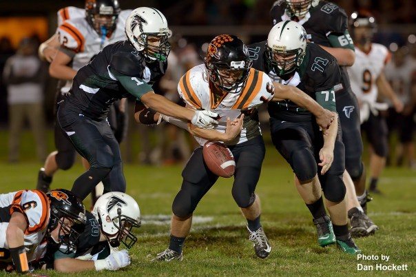 Photo by Dan Hockett West Burlington / Notre Dame Defensive Back Xavior Williams (1) knocks the ball loose from Mediapolis Running Back Cole Erickson Friday night in West Burlington. WBND recovered the fumble.  Mediapolis defeated WBND, 38-33.