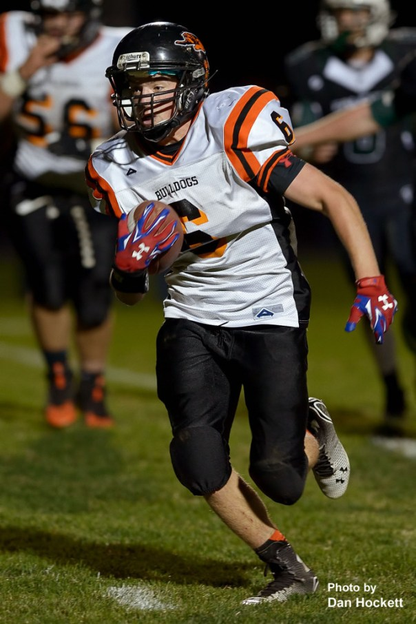 Photo by Dan Hockett Mediapolis Running Back Josh Osborne carries the ball against West Burlington / Notre Dame Friday night in West Burlington. Mediapolis defeated WBND, 38-33.