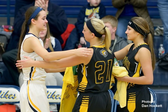 Photo by Dan Hockett New London Teammates Victoria Noel (21) and Paetyn Prottsman (right) present Notre Dame's Johanna Myers (left) with an autographed t-shirt supporting her father Jim Myers' battle with cancer.