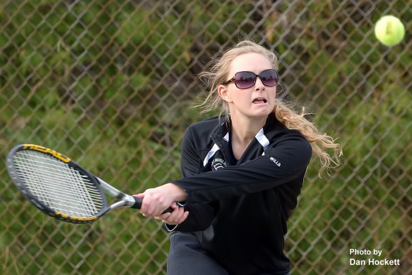 Photo by Dan Hockett Notre Dame – West Burlington's Stephanie Wills returns the ball during a doubles match with Maharishi Monday afternoon at Dankwardt Park in Burlington. NDWB defeated Maharishi, 9-0.