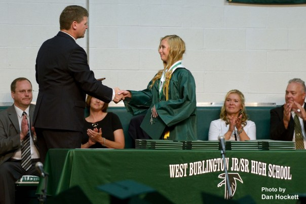 Photo by Dan Hockett West Burlington's Stephanie Wills (right) receives Valedictorian award from High School Principal Bruce Snodgrass (left) during graduation ceremonies Sunday afternoon in West Burlington.