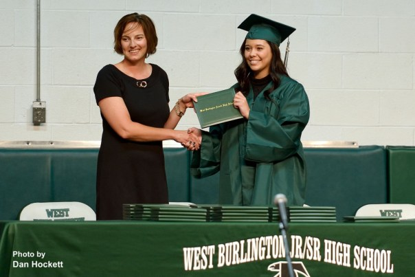 Photo by Dan Hockett West Burlington Senior Machaela Diaz (right) receives her diploma from School Board President Michelle Randall (left) during graduation ceremonies Sunday afternoon in West Burlington.