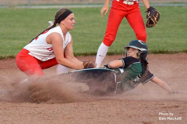Photo by Dan Hockett West Burlington – Notre Dame's Courtney Coffin looks for the call after being tagged out by Highland Shortstop Bridget Murphy at second in the sixth inning of Friday night's game in West Burlington. Highland defeated WBND, 4-2.