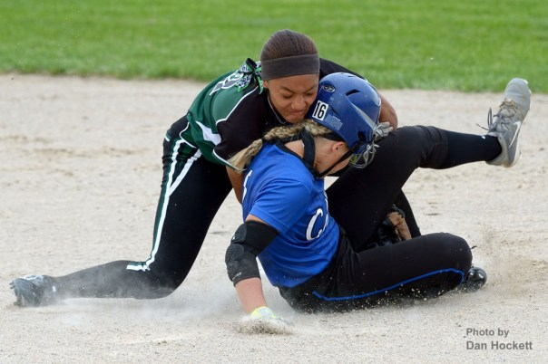 Photo by Dan Hockett West Burlington – Notre Dame Shortstop Jashira Baylark (left) tags out West Liberty's Macy Akers (right) as Akers slides to second in the first round of Regional play Wednesday night at West Liberty. West Liberty defeated WBND, 3-1.